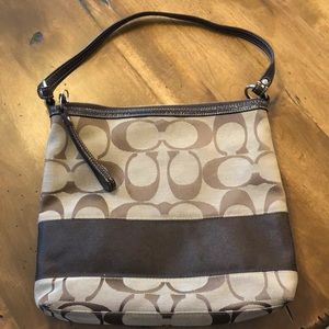 Coach bag with extra cross body attachment.